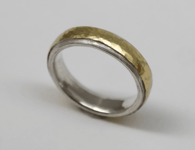 Sterling silver, 18 carat yellow gold detail